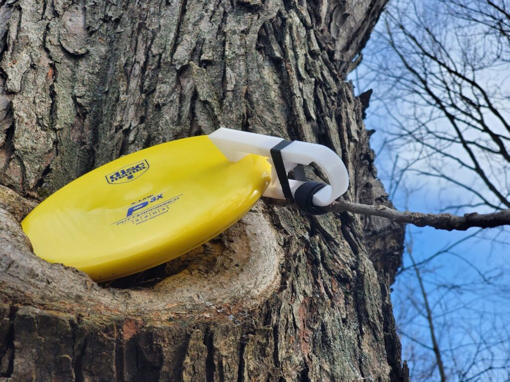 Grab your disc from a tree.